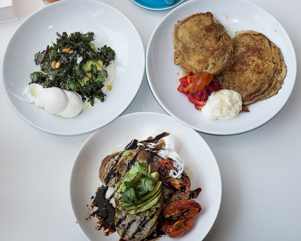 A few of the food options: kale breakfast salad with poached eggs, avocado and slow roast tomatoes on toast, buckwheat pancakes with quince and raspberries and yoghurt.