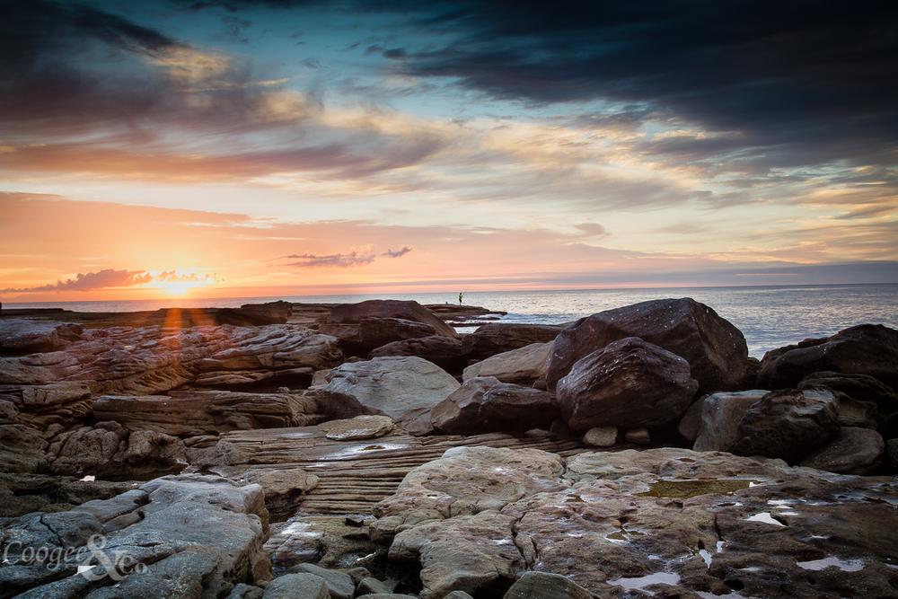 Rock fishing at sunrise.