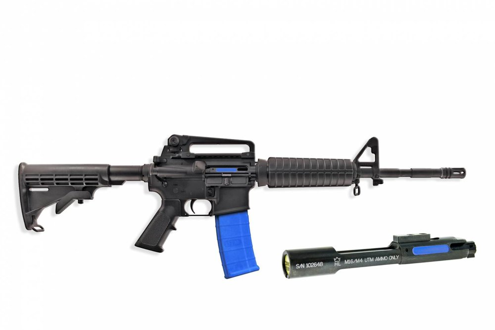A UTM-equipped AR-15 style carbine, and a UTM bolt.