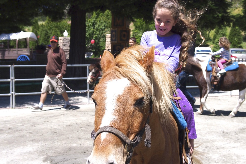 Maisy having a blast riding her pony.