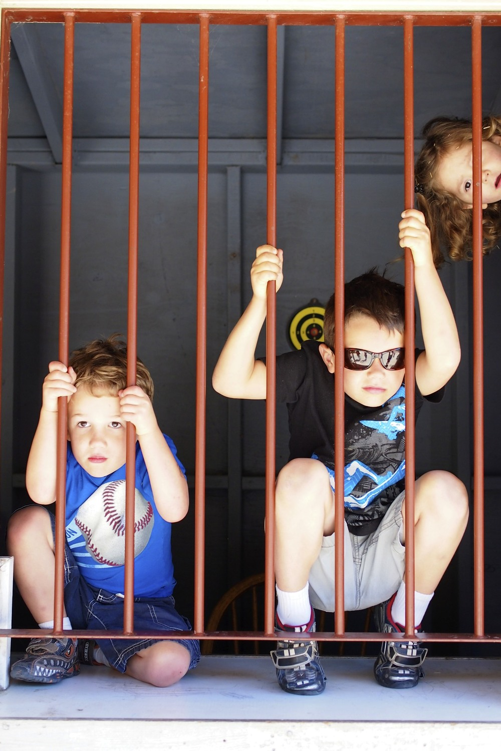 Reid and Rowan trying to bust out of jail.  Can you spot the photo bomber?