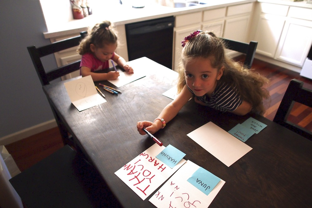 Maisy getting going and Maren working on Father's Day cards.