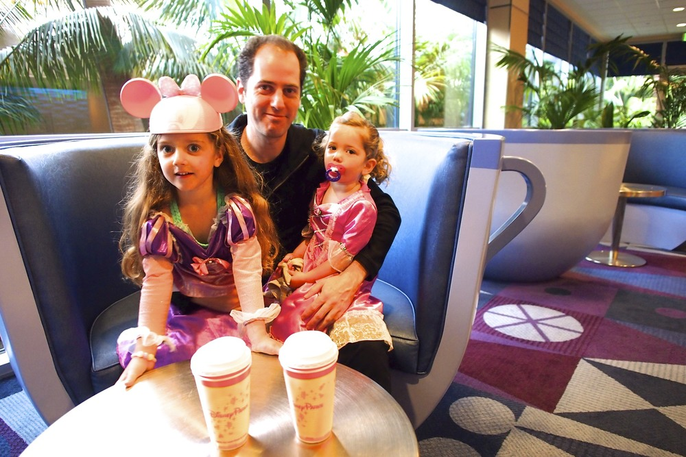 Daddy and his princesses as they were about to enter Disneyland!