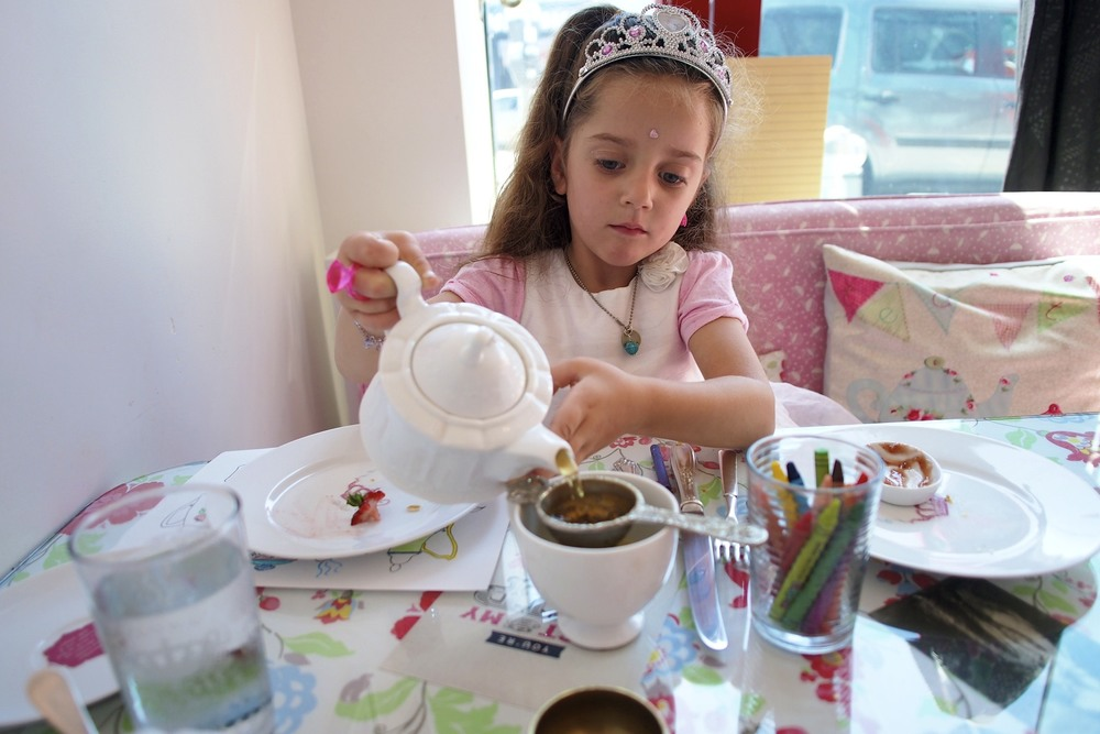 I can't believe she's old enough to successfully pour her own tea!