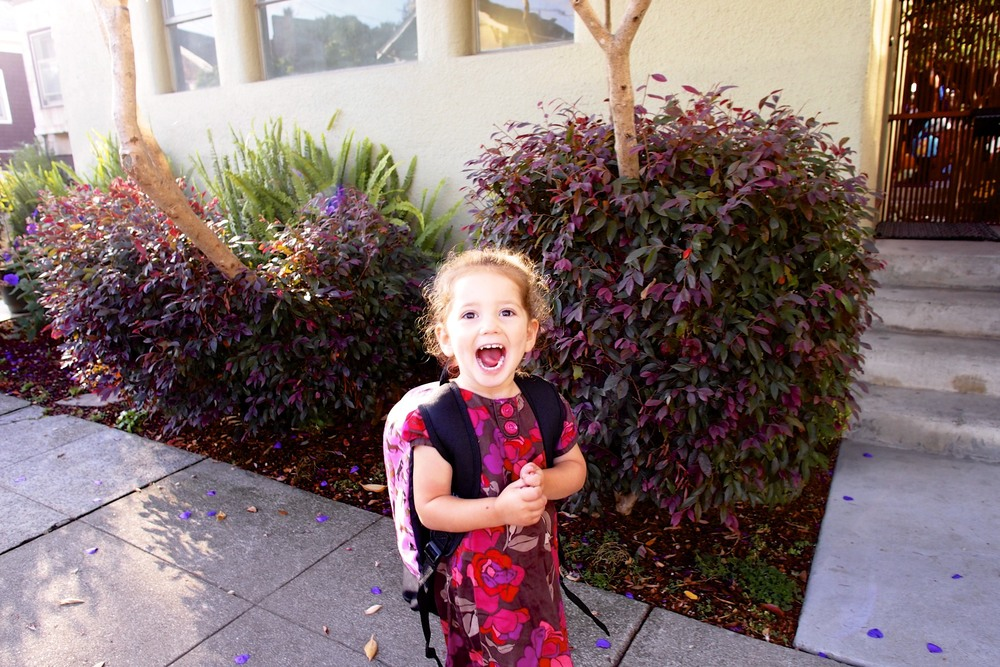 Beaming as she finally gets to go to preschool like she watched her big sister do for TWO whole years.