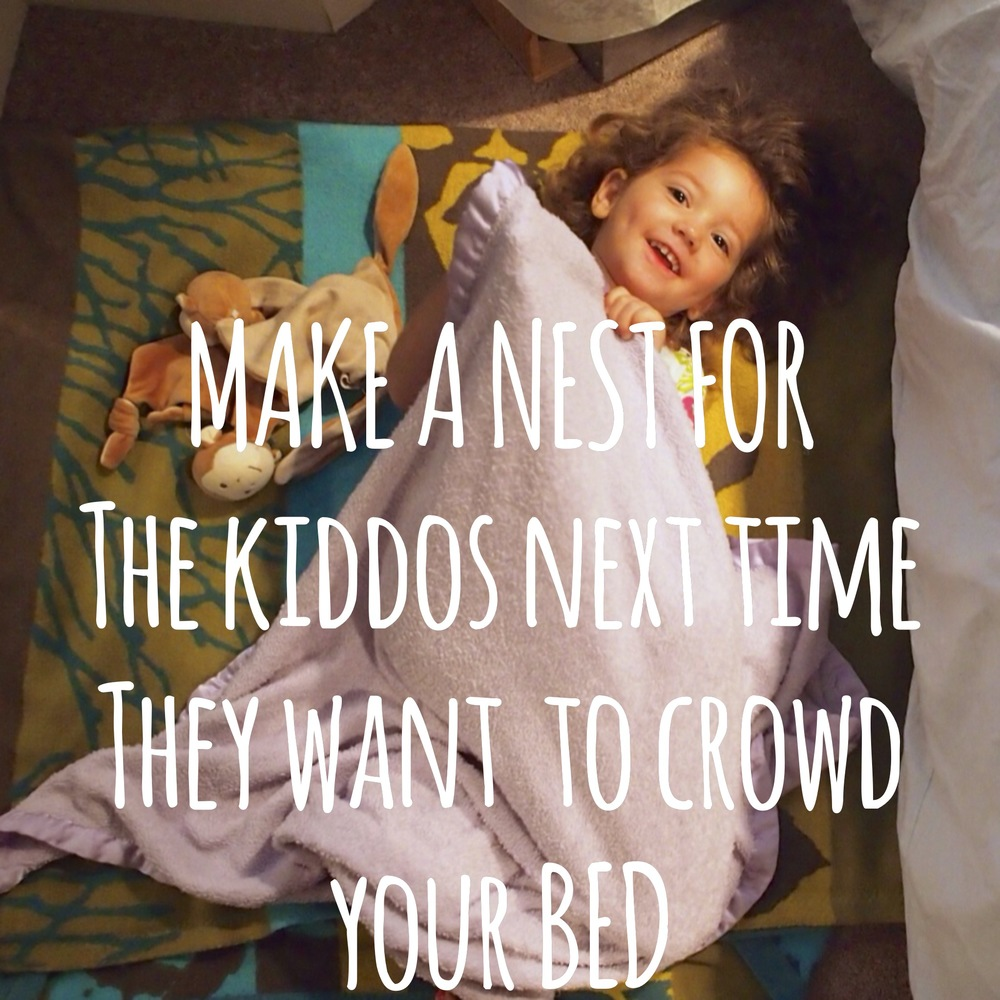 Make a nest on the floor next to your bed for late night kiddo visits.