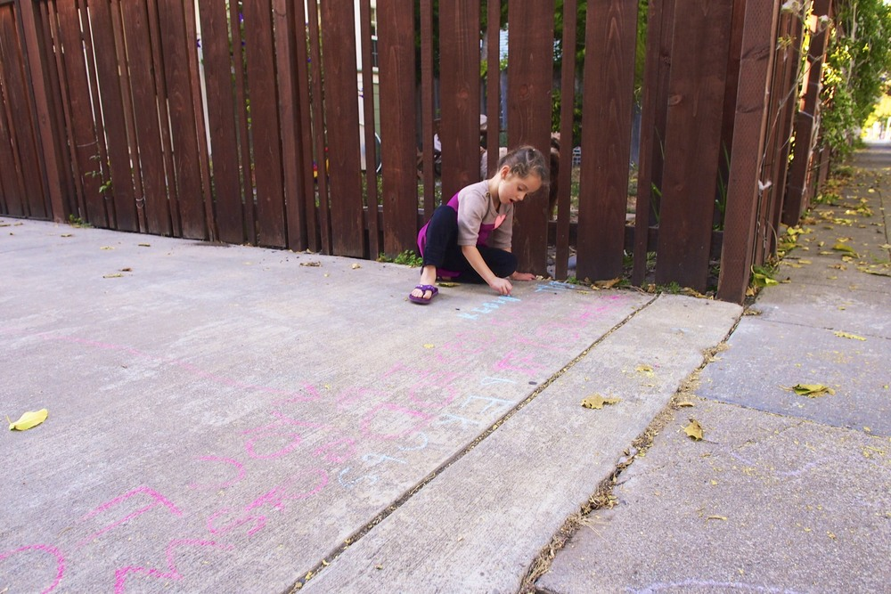 "Maisy chalk writing in kindergarten spell language.  ""Becky food pick up here. If you have kids you should bring them."""