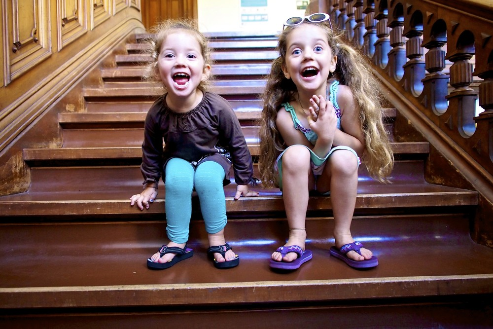 Maren and Maisy on the steps inside of South Hall.  Beautiful wooden stair cases.