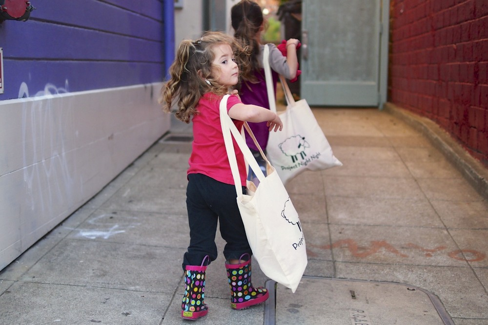 The girls bringing their Project Night Night bags in for donation. (heart melting)