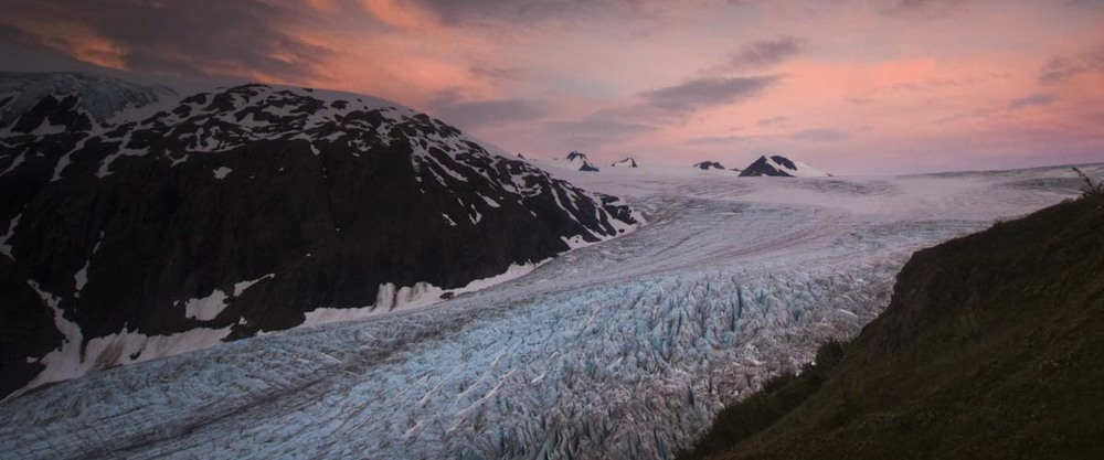 A midnight sunset blankets Exit Glacier in pastel hues. Near Seward AK.