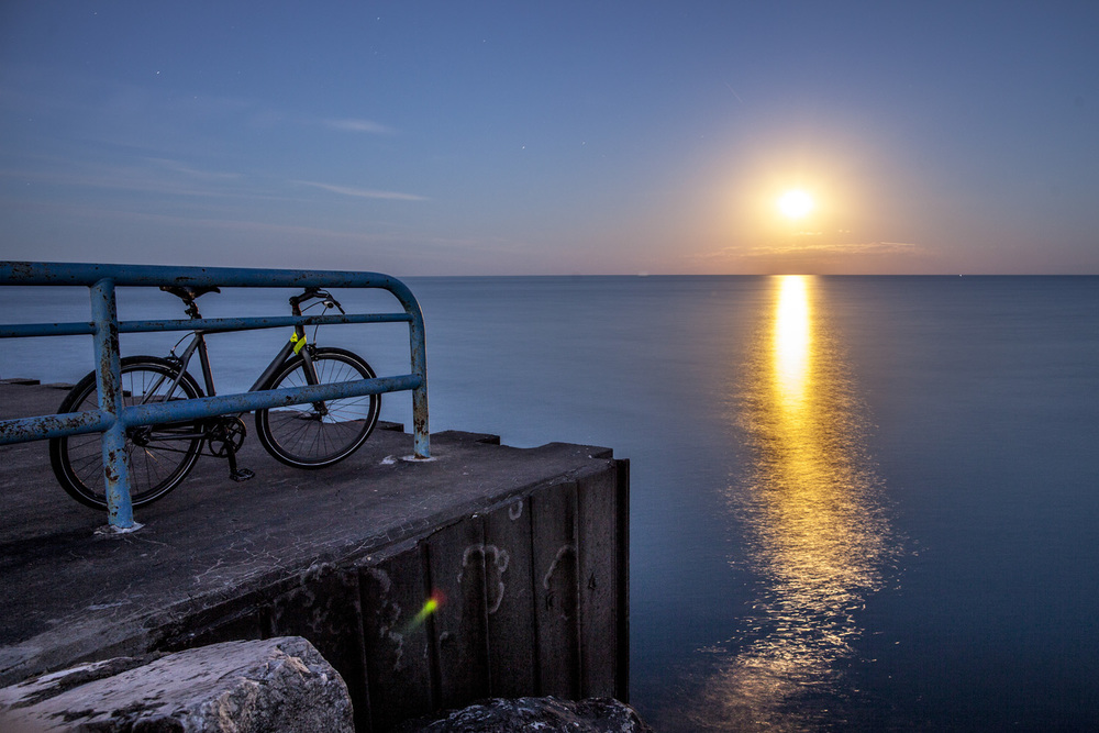Full Moon Rise over Lake Michigan. Milwaukee Breakwater, WI.