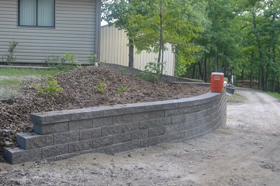 Brand new curved, sloped retaining wall