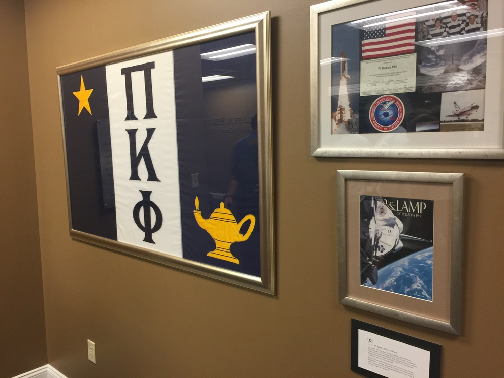 This flag has been to the moon, no Pi Kapp flag has traveled farther