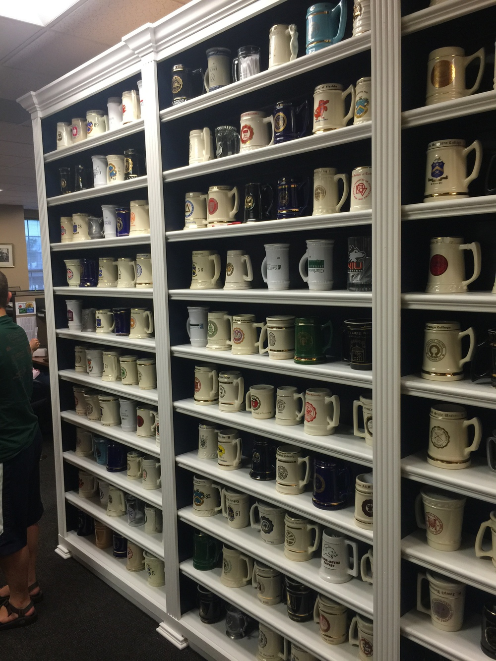 The Mug Wall, there is a mug from every university that has a Pi Kapp chapter at it. If the mug is right side up the chapter is open, if it is upside down it is closed. When you visit you can write a note and put it in your mug.