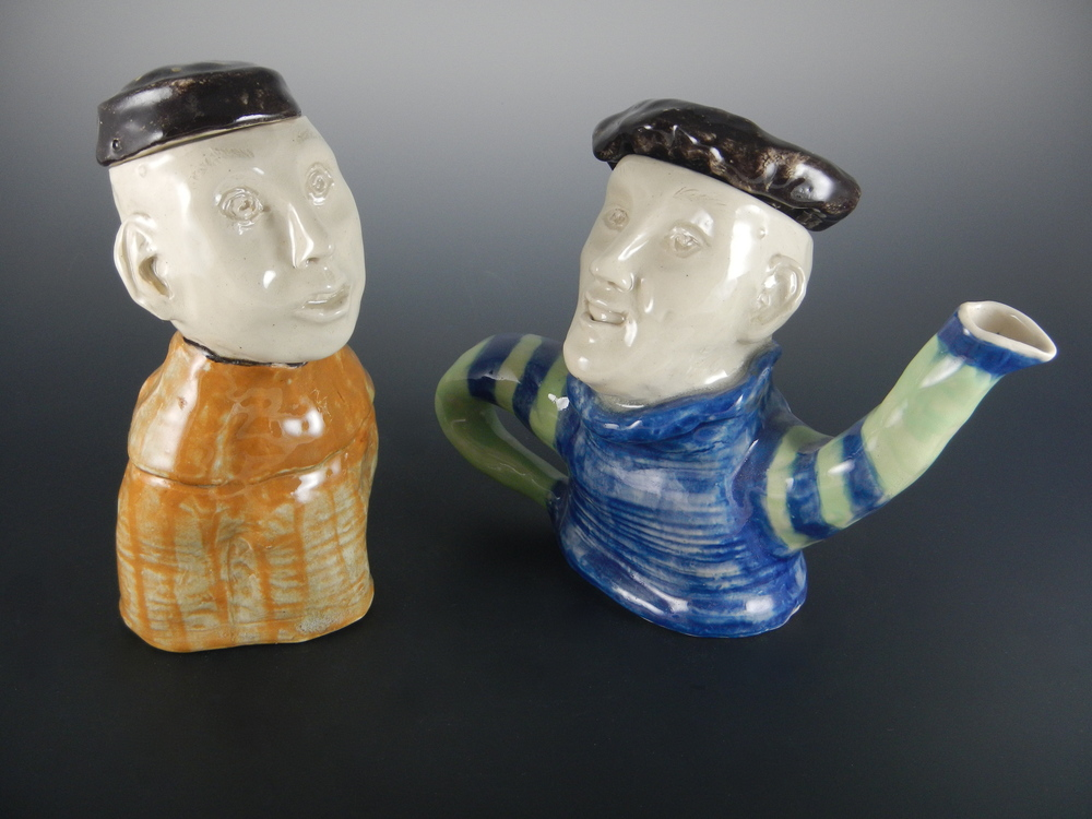 "(""Marketplace Tea"", 2000. The fellow who is not a teapot is a sugar bowl. They used to have a goat creamer, but it broke... By Mimi Stadler Pottery. Photo by the artist, 2014.)"
