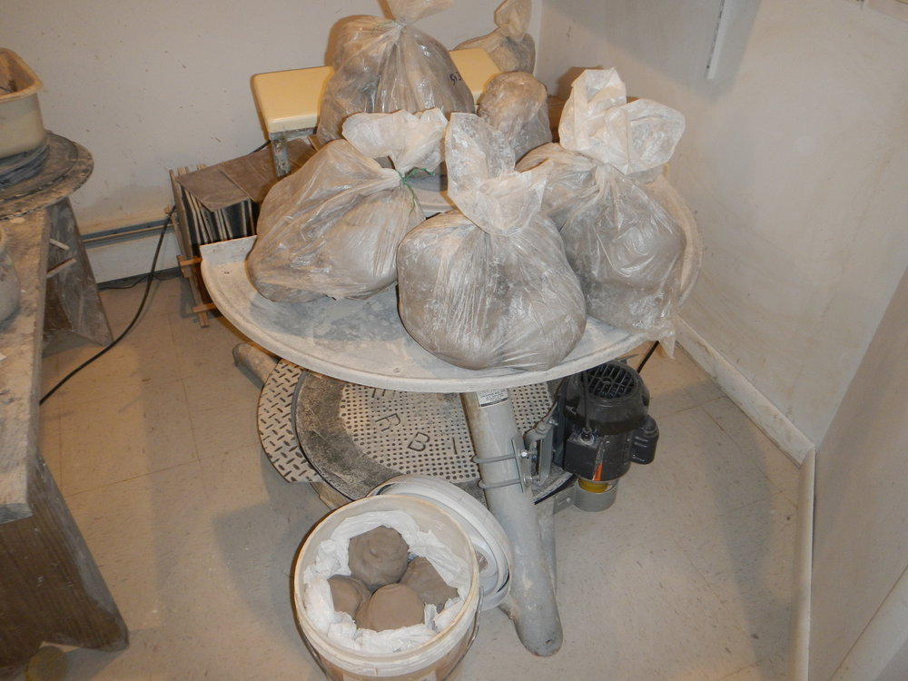 3 1/2 hours of reclaiming and wedging. This is what 130 lbs. of recycled and wedged clay looks like.