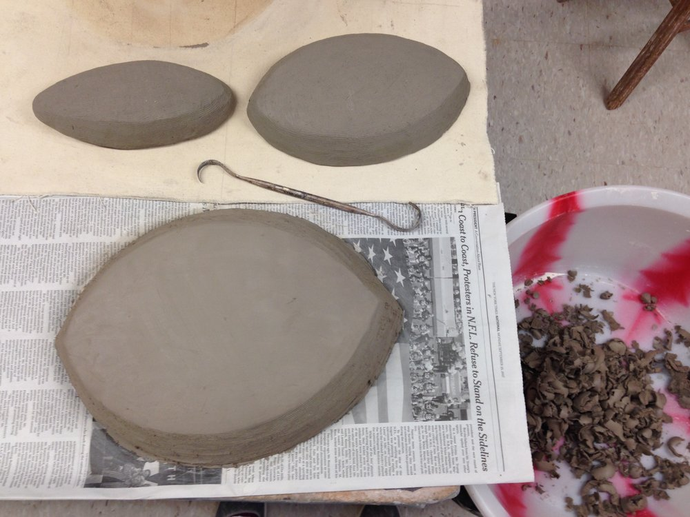 Initial solid humps of clay, basically patted into shape and groomed around the edges.