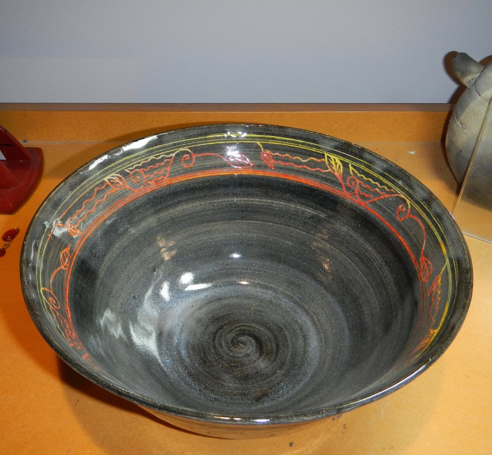 For example- I have a related (but not exactly the same) grouping of bowls, sgraffito color on black.