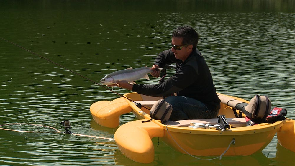 Don-in-Frog-Boat-with-big-fish.jpg