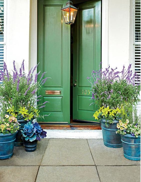 A green front door denotes nature and wealth in Feng Shui practices.