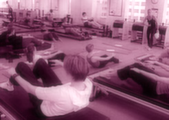 A typical crowded Pilates studio.  Never private, and hardly focused on you alone.