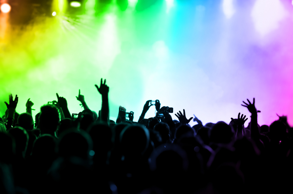 cheering crowd in front of colorful stage lights  © DWP - Fotolia.com