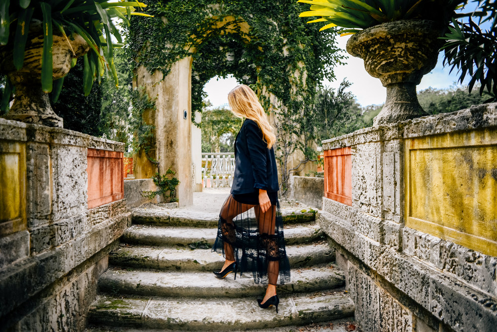 Blogger Ana Prodanovich walking up steps in Vizcaya Museum and Gardens - Stills by Hernan - stillsbyhernan.com
