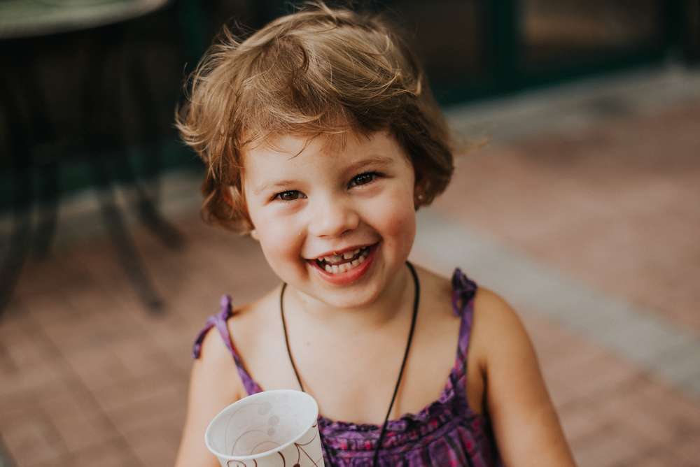 Little girl laughing food and thought naples florida portrait photographer collier county