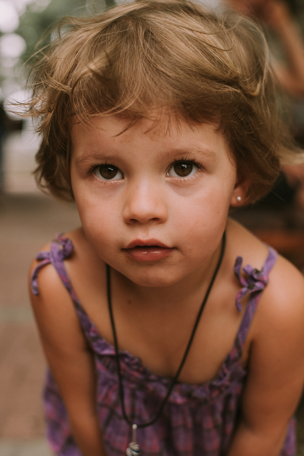 Little girl looking into camera food and thought naples florida portrait photographer collier county