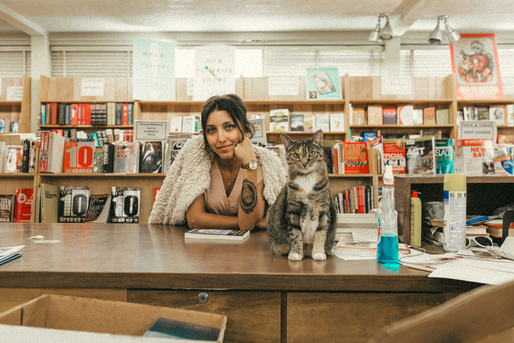 Hillary with the bookstore cat - couple portraits - st pete florida - naples florida wedding photographer - tampa wedding photographer