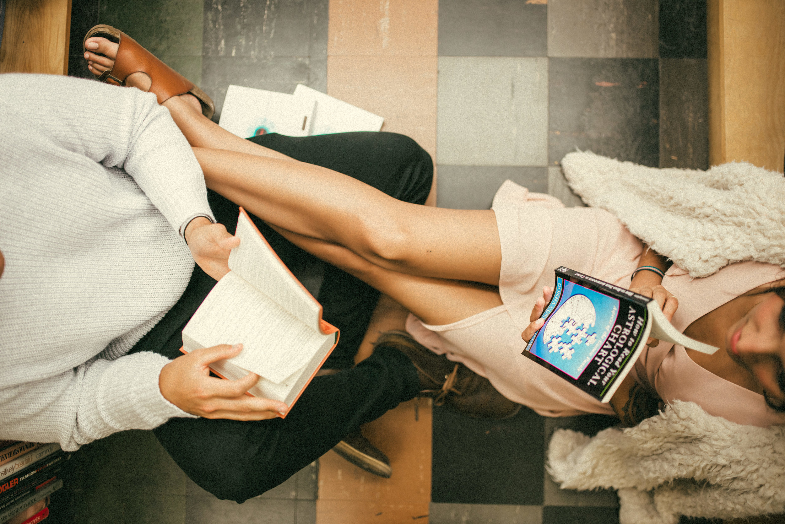 Hillary & Brandon sitting on bookstore floor - couple portraits - st pete florida - naples florida wedding photographer - tampa wedding photographer