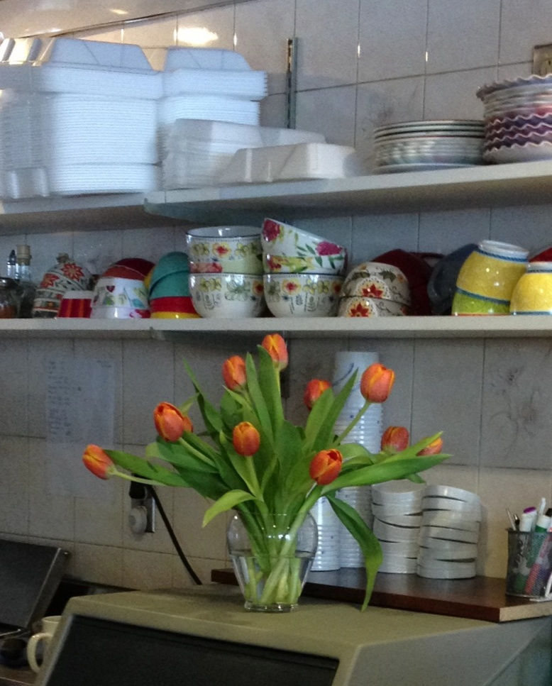 Tulips behind the counter … they were on a table … but room for sitting and eating was needed … I ate my tuna melt with flowers in sight!