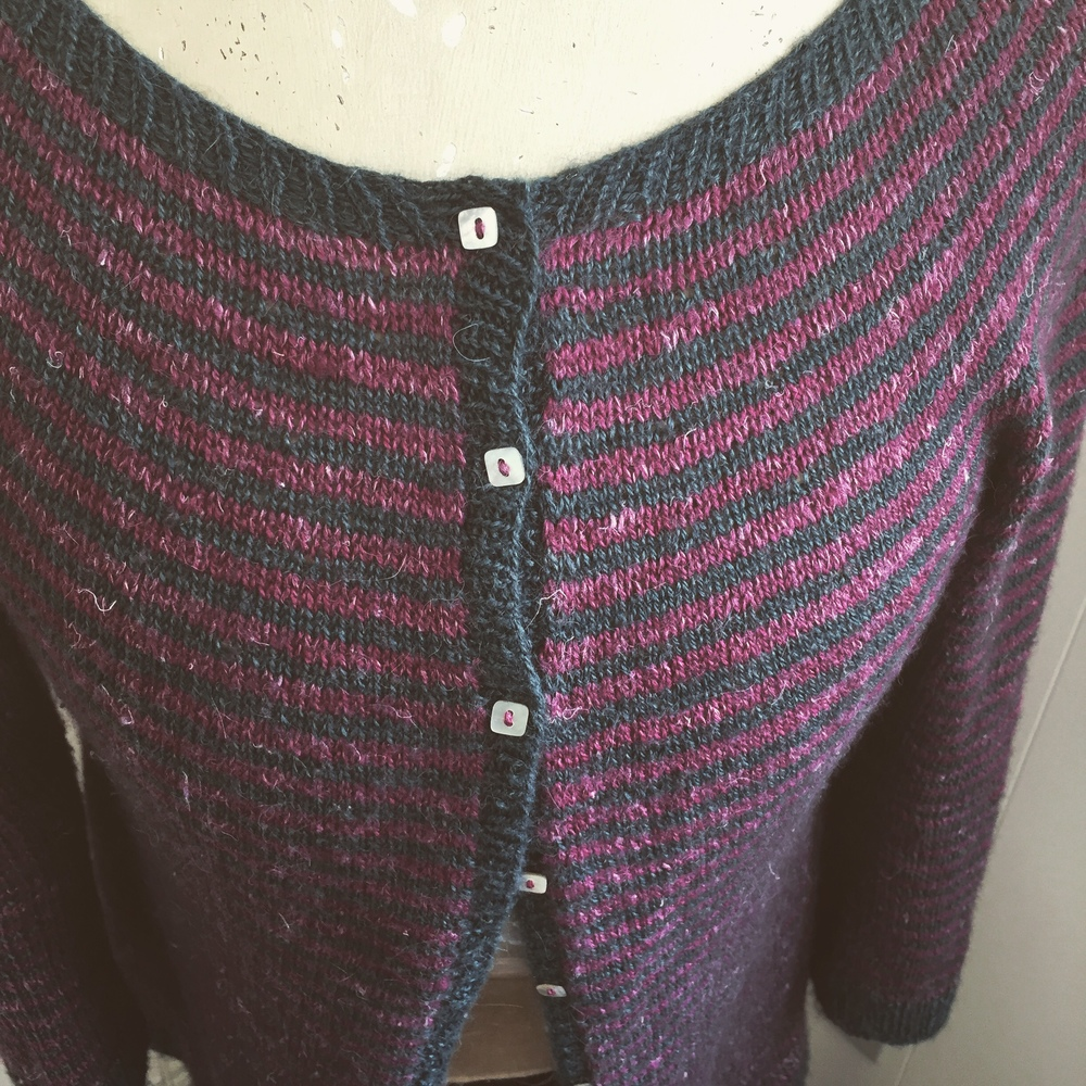 ... little tiny square buttons ... mother of pearl ... sewed on with the read stripe color ... pokeweed!