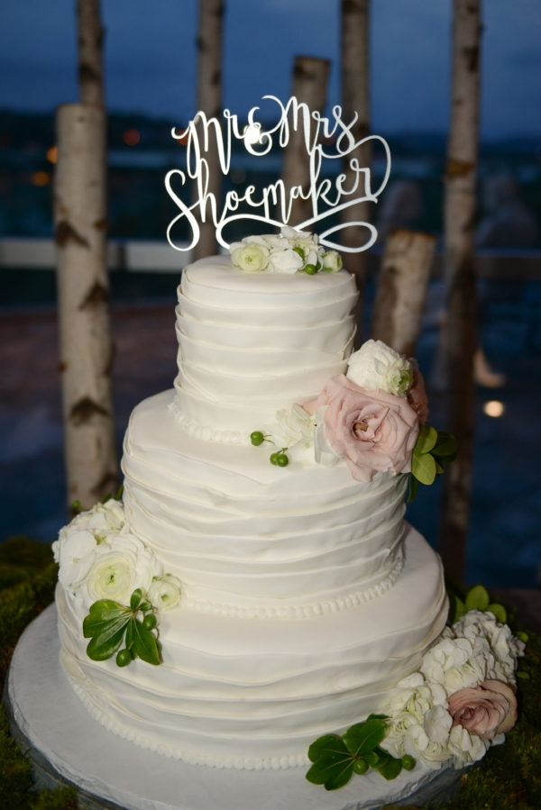 The customized wedding topper adds a celebratory feel to this beautiful cake showcasing the couple's new shared last name.