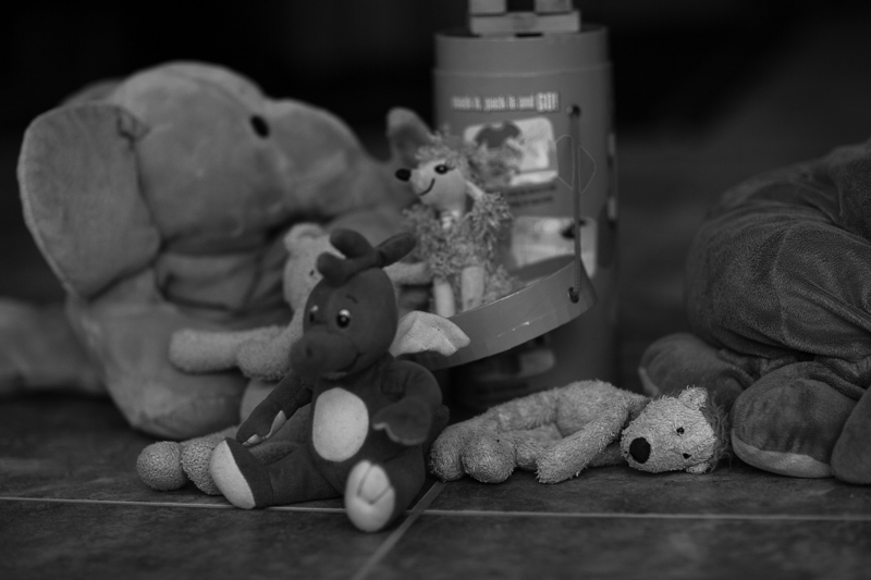 toys on floor bw