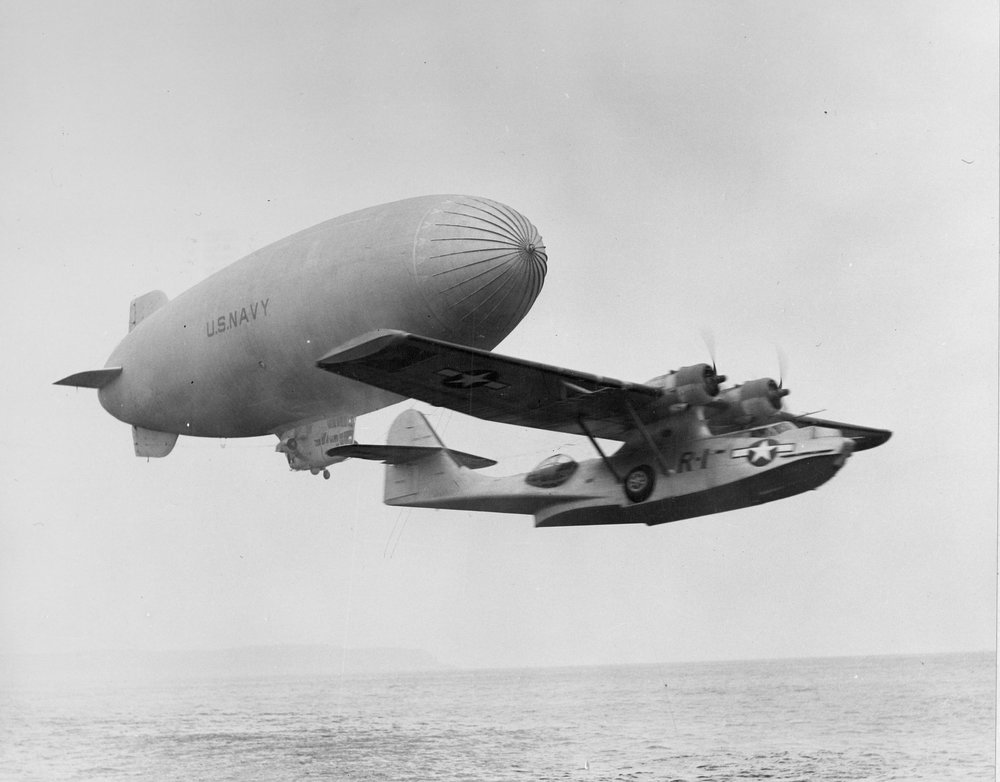 A PBY Catalina with a search and rescue blimp. Credit: Lost in the Pacific/National Archives.