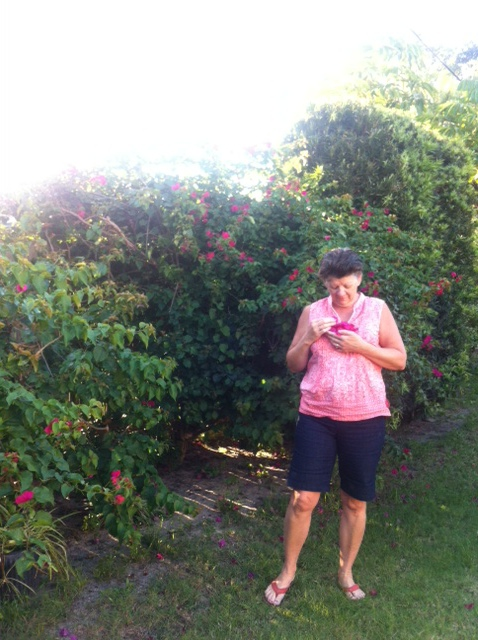My beautiful Mother collecting blooms.