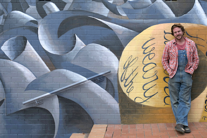 Rudy Kistler in front of the Goulburn library mural