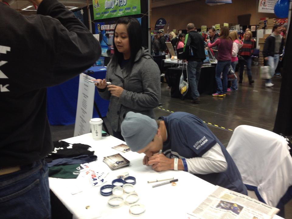 Signing autographs at USABA booth. Up close and personal :)