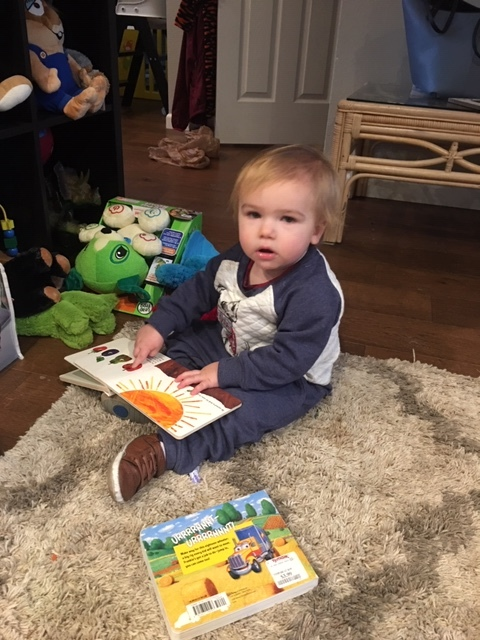 Kennan is learning words and how to read basic books so he can read them to daddy.