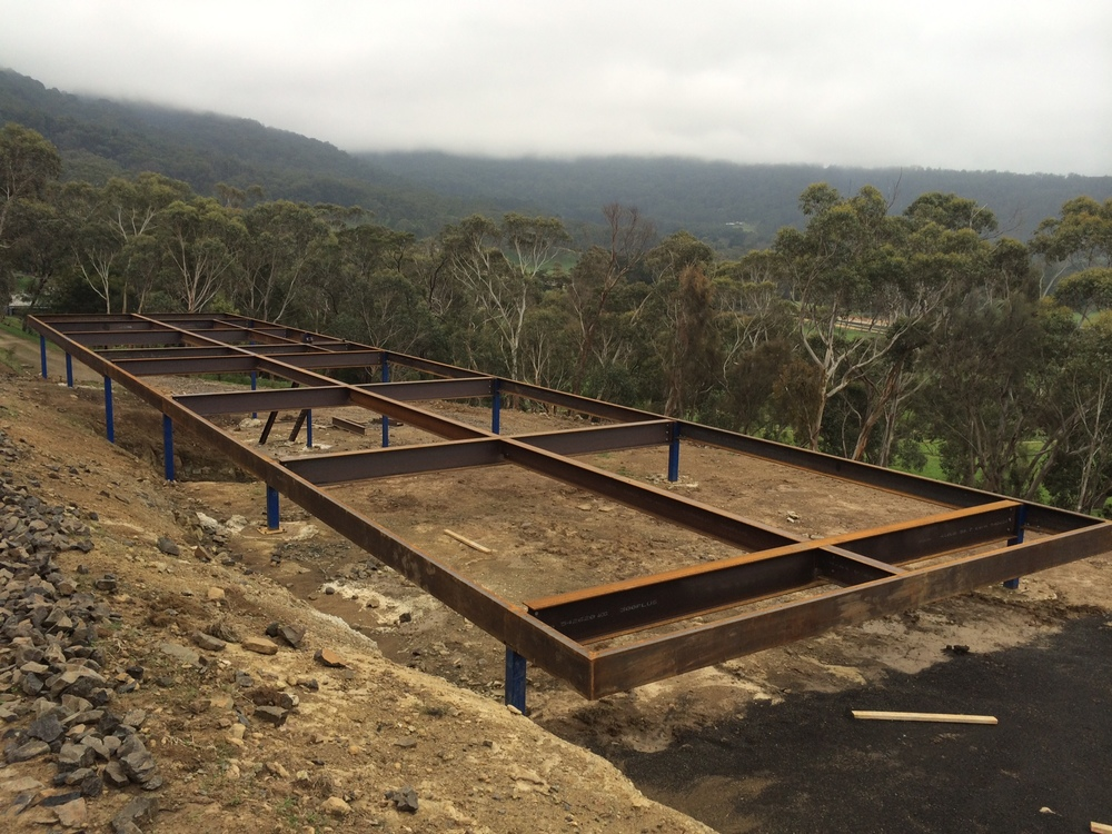 37m long x 7m wide and up to 4m high steel frame cantilevering towards macedon ranges