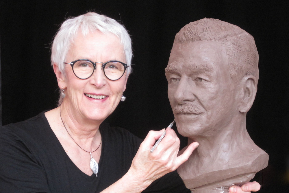 """Pat with """"Jim"""" in clay."""