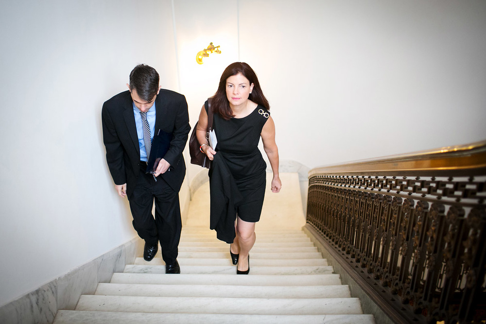 Senator Kelly Ayotte (R-NH) walks with military legislative assistant to Brad Bowman to an Armed Services Committee meeting.