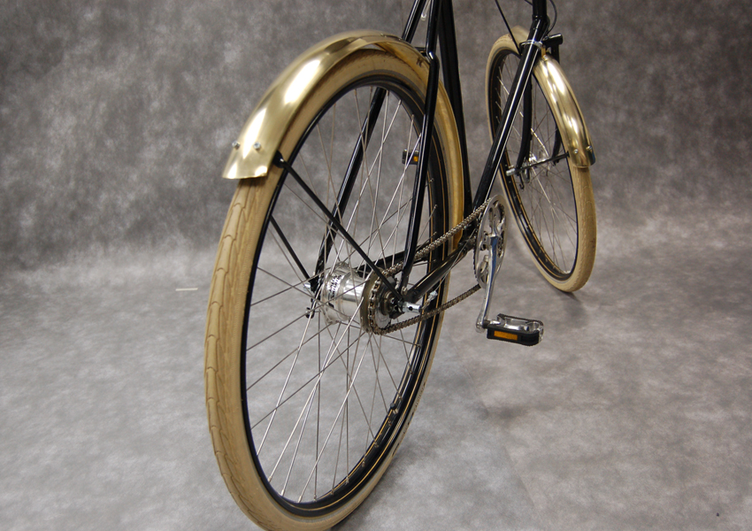 Brass mudguards by Thomas Slack
