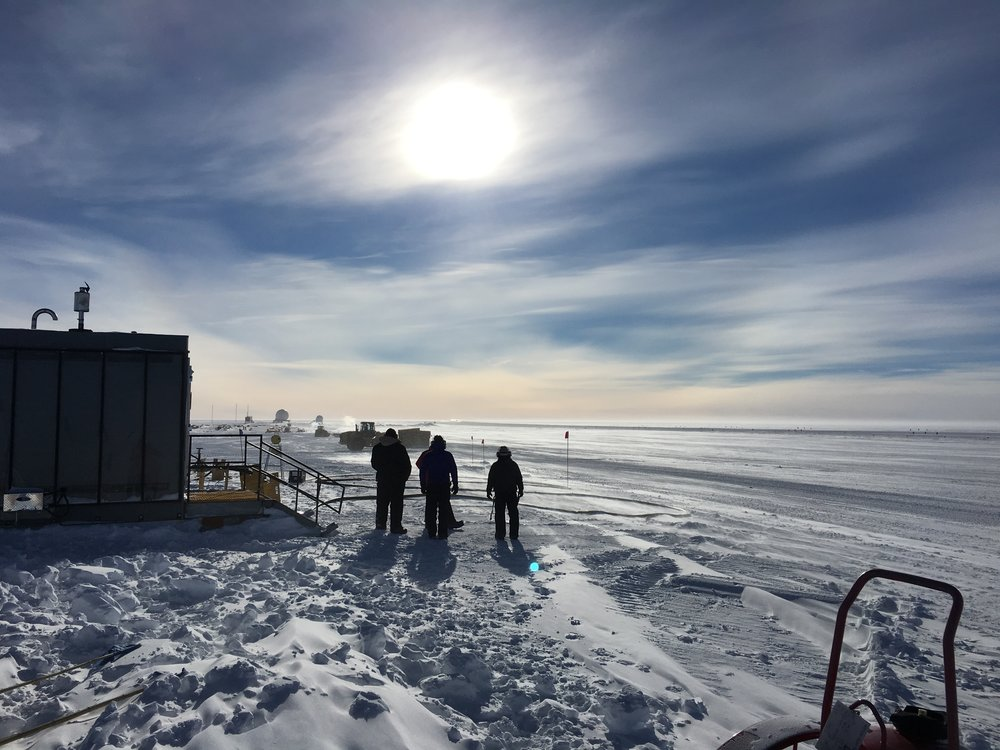 South Pole airfield cargo crew, watching a flight take off