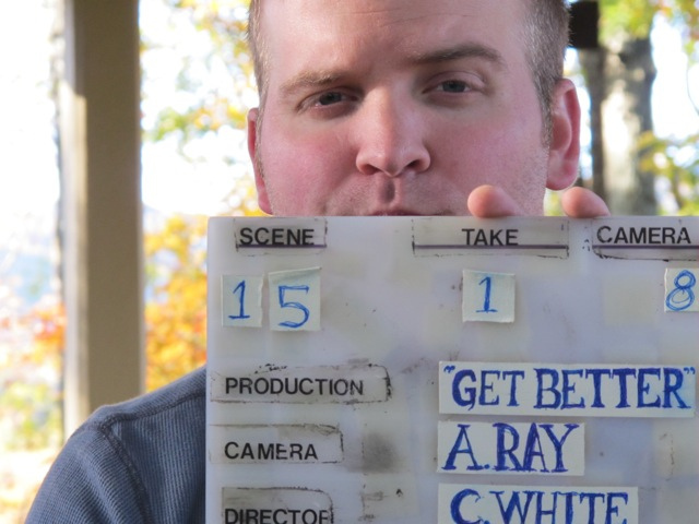 Dan Reach holds the slate for GET BETTER.