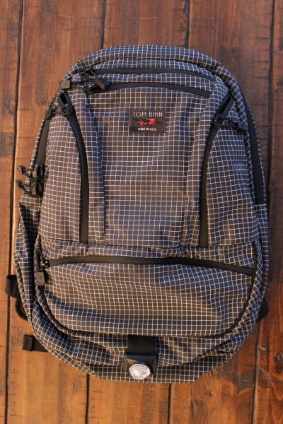 Over here at The Man's Man we are sold on the packs that Tom Bihn puts out. Tom Bihn (the man) has been designing packs for more than 40 years and he feels a personal responsibility to put out a product that is unique, looks good, lasts long, and fills a niche that no one else has filled. He's doing an excellent job at fulfilling this purpose. These packs are functional and quality made. After using the Smart Alec pack for the last 5 months for everyday carry and day trips we were really excited to get our hands on the newest pack from the guys at Tom Bihn. The Synapse 25 is the big brother to the Synapse 19. Not only is the 25 a larger version of the 19 it also introduces 5 new design updates to the Synapse line.