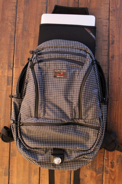 The front of the Synapse 25 is super clean with 5 zippered pockets. Inside those pockets you will find a couple more design updates. They have added more O-Rings for attaching  items and the left front pocket of the Synapse 25 has a pen/pencil slot and a couple wider slots for other gear organization.You will find the 4th design update on the bottom pocket. There was piping added to help it keep it's shape even when empty. The final design update is the botom webbing loop. In the picture above the Guardian Dual Function Light is attached to that loop for biking or walking at night.