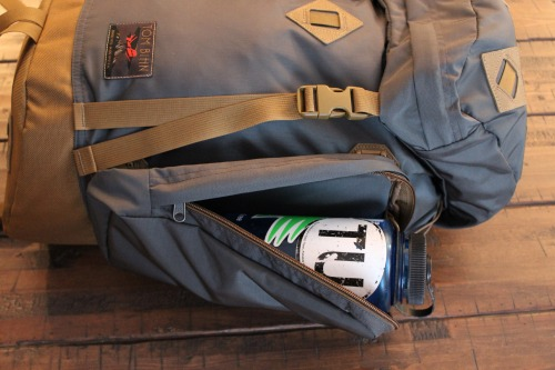 The Guide's Pack has two optional side pockets. One of the pockets is the perfect size to hold a water bottle or extra gear. The zipper is flap covered and runs up the top and the side for better access. Under the side pockets, you'll find a secret zipped pocket that can hold your phone, wallet, or keys. These side pockets are optional but we recommend using them.