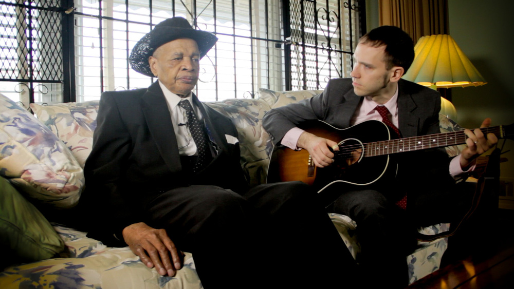 Elijah & Jeremiah New Yorkers of the mid-90's may recall the startling sight of a young Jewish teenager and an elderly black southerner (Carolina Slim) playing the blues in the subway. This is their story, retold, ten years later.